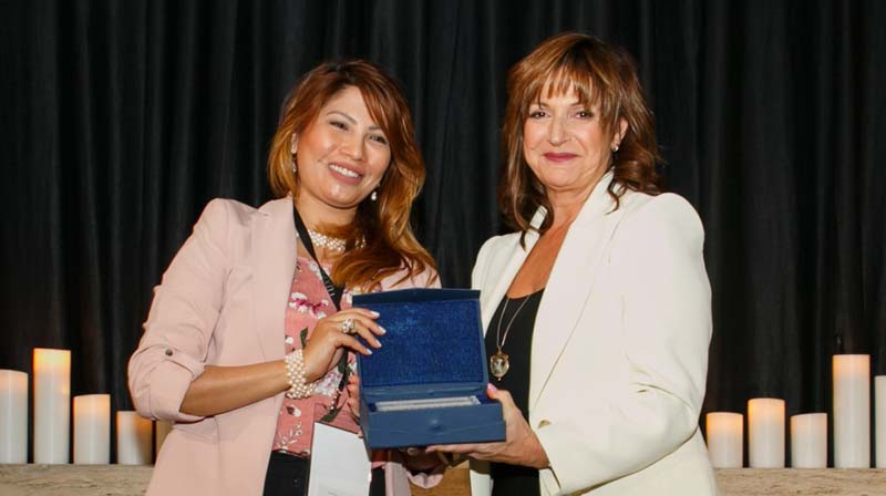 The Farm at San Benito's Director of Sales and Marketing, Jennifer Sanvictores, accepting the Connections Award from LUXPERIENCE Event Director Michelle Papas
